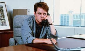 "Michael J. Fox in the film ""The Secret of My Success."""